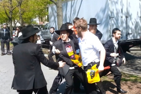 "On Lag B'Omer (April 28, 2013) Crown Heights Shmira Mesira members Menachem Kozlovsky and Moshe Kozlovsky attacked and beat two Kvutzeh Meshichistim ""Bochurim"" in front of 749 Eastern Parkway. Apparently they were trying to take away ""Moshiach"" flags. The were assisted by Shloime Hecht from the organizers of the parade."